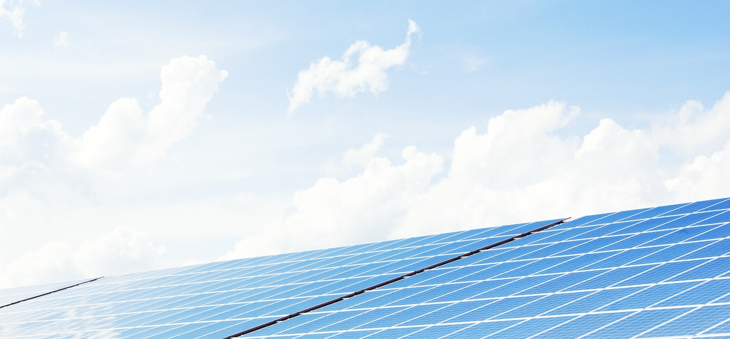 PV*SOL header image with blue sky, clouds and PV modules